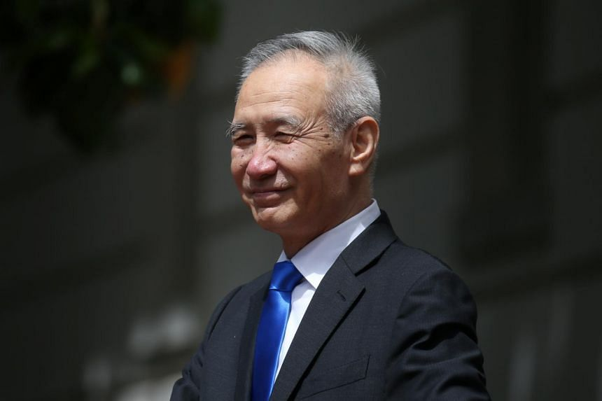 China's Vice-Premier Liu He exits the office of the US Trade Representative following a morning round of negotiations on the second day of trade talks in Washington, on May 10, 2019.
