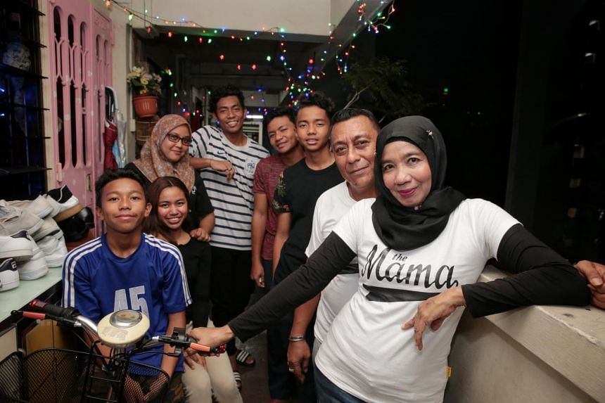 (From right to left) Madam Taksiah Razak, 56 and her husband Mr Mohd Jaaffar Muid, 54, with her children Ahmad Isnin, 15, Muhammad Iskandar, 17, Sulaiman, 19, Nurul Amalina, 22, Maimunah, 21, and Ayob, 13, pose for a photo at their home in Jalan Bers