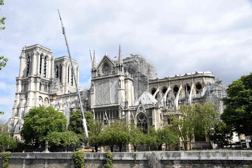 People work as part of the construction work to secure Notre Dame de Paris cathedral on May 10, in the wake of a huge fire on April 15, 2019.