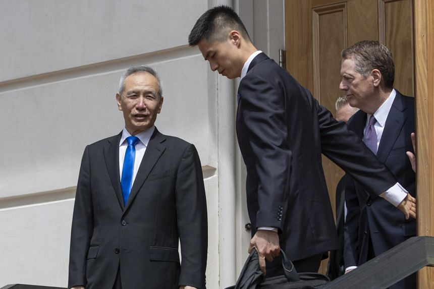 China Vice-Premier Liu He (left) says goodbye to US Trade Representative Robert Lighthizer (right) after trade talks at the offices of the US Trade Representative in Washington on May 10, 2019.