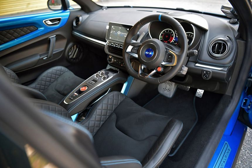 In the Alpine A110, the one-piece bucket seats are comfortable and there is a generous array of modern amenities. The handsome rear, with its flared haunches and squat posture, contributes to the car's unshakeable roadholding.