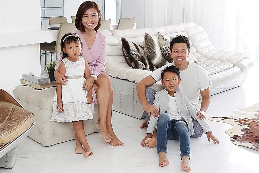 Mr Eugene Soo, 37, an estate planner at Rockwills International, with his wife, Ms Ho Siew Ling, 38, a financial adviser, and their children - Esben, eight, and Esther, five. Mr Soo has established a family trust that aims to preserve the family weal