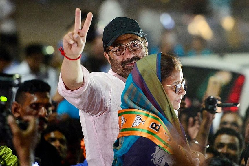 Former actress Urmila Matondkar, who joined India's main opposition Congress party, at her election rally in Mumbai last month. Indian actor and Bharatiya Janata Party candidate Sunny Deol (in pink), who is contesting the Gurdaspur parliamentary seat