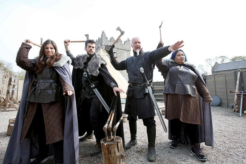 Game Of Thrones fans take part in axe-throwing with Master of Arms Will van der Kells (second from right) at the Castle Ward Estate in Strangford, Northern Ireland, the location of Winterfell in the hit HBO series.