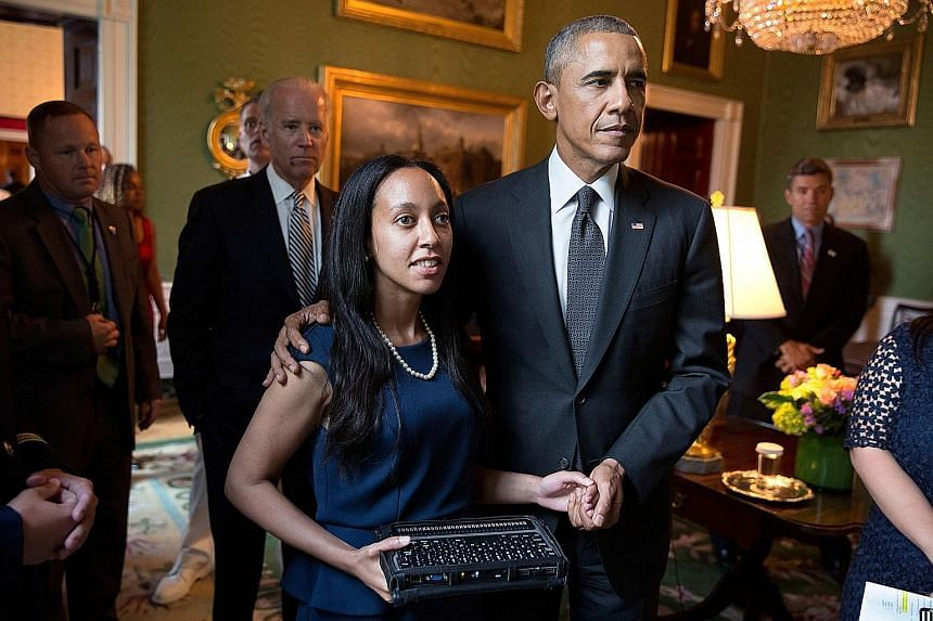 Miss Girma with then US President Barack Obama on the 25th anniversary of the Americans with Disabilities Act in 2015.