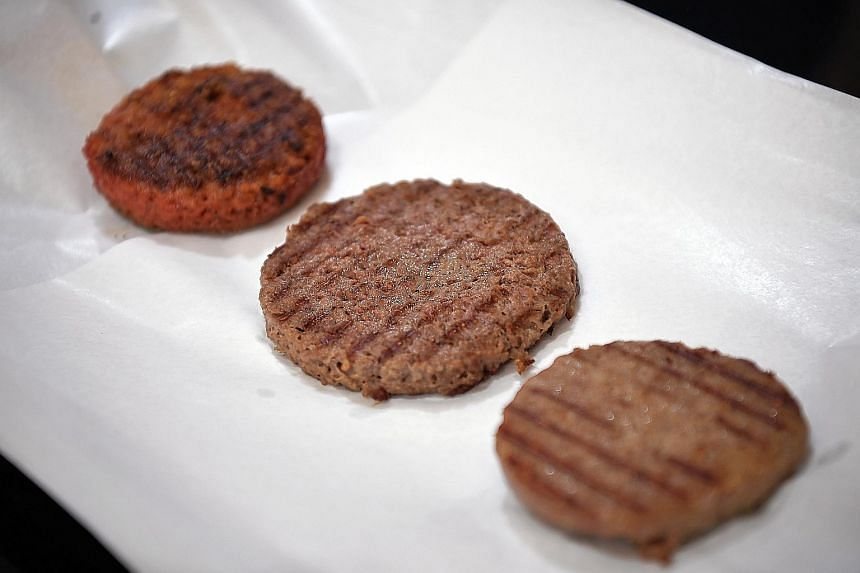 Cooked patties made of (from left) Beyond Meat; Impossible meat; and real beef.