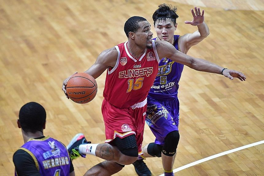 Singapore Slingers' Xavier Alexander attempts to make a play for his side amid the close attention of CLS Knights' Wong Wei Long during their Game 4 defeat by the Indonesian team. The championship-deciding Game 5 will be played at the OCBC Arena in S