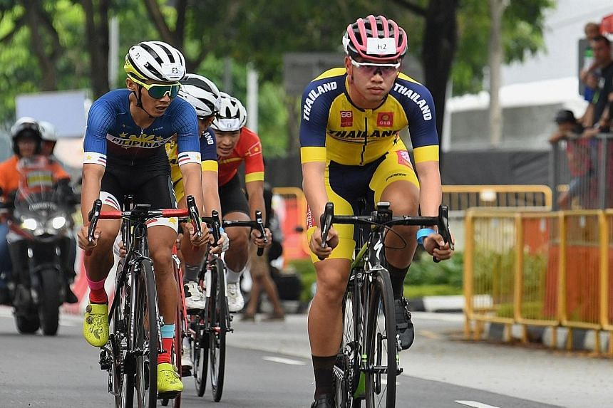 The Filipino rider biding his time behind the Thai leader en route to his team winning the OCBC Cycle Speedway SEA Championships yesterday.