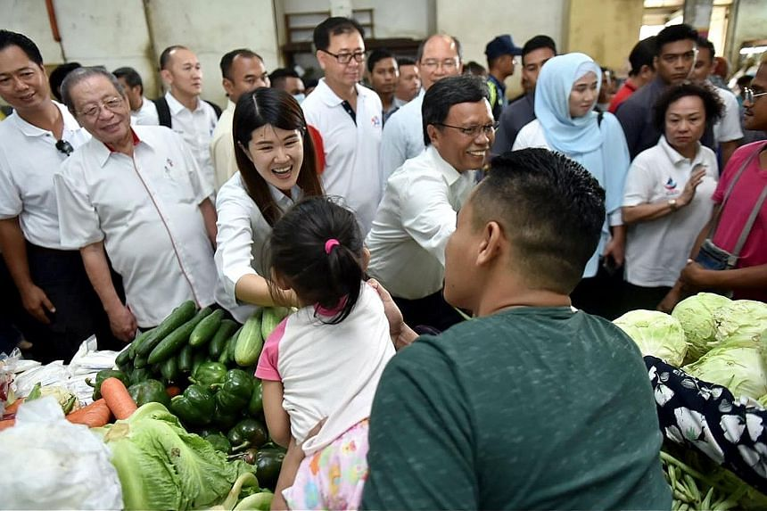 Democratic Action Party's Ms Vivian Wong at a market in Sandakan last week. She is flanked by Sabah Chief Minister Shafie Apdal (on her left), who is the head of Pakatan Harapan's partner Parti Warisan Sabah, and veteran DAP leader Lim Kit Siang.
