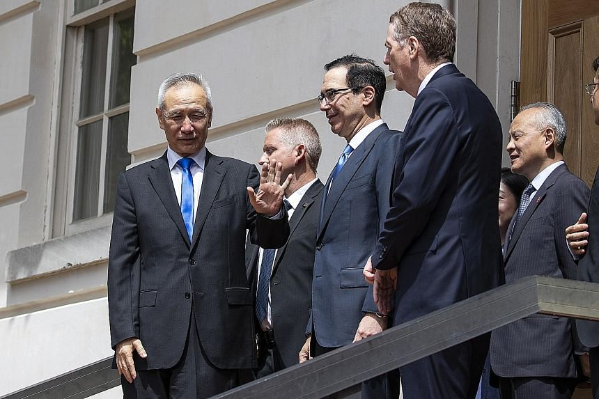 Chinese Vice-Premier Liu He (left) leaving the Office of the US Trade Representative in Washington following a meeting on Friday with (from right) US Trade Representative Robert Lighthizer and US Treasury Secretary Steven Mnuchin. Mr Mnuchin said no