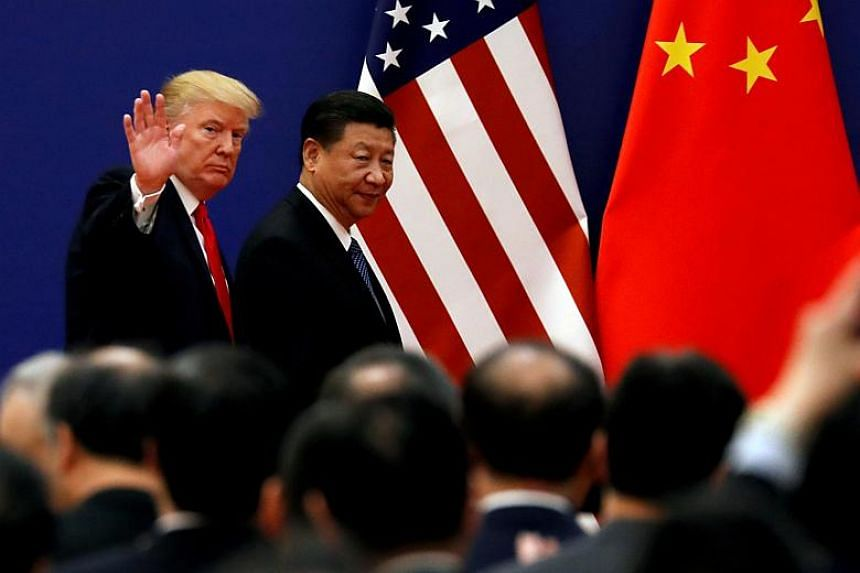 US President Donald Trump and Chinese President Xi Jinping meet business leaders at the Great Hall of the People in Beijing, China, on Nov 9, 2017.