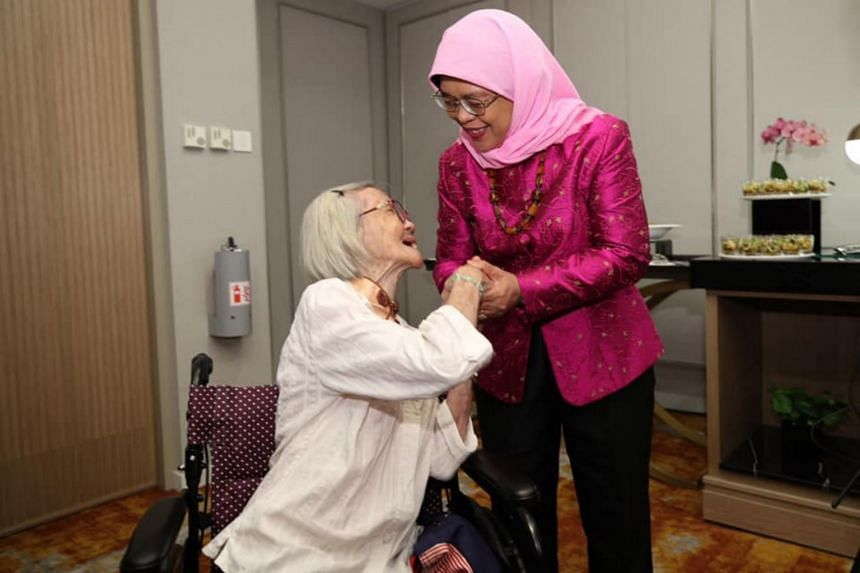 President Halimah Yacob with 91-year-old Madam Chua Bang Choo, who devoted her entire life to caring for her 62-year-old son who is intellectually challenged.