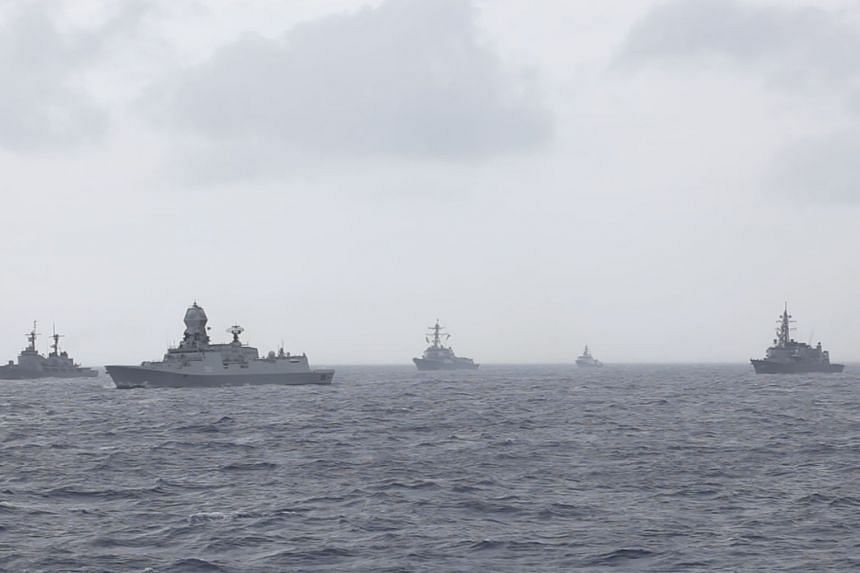 Ships of the ADMM-Plus navies sailing in formation en-route to Singapore.