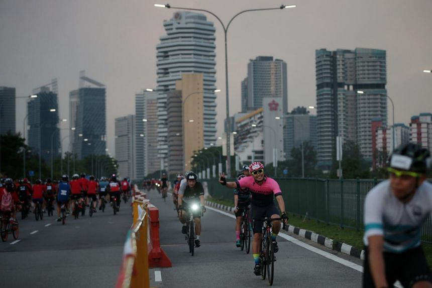 Cyclists take part in the Straits Times Ride (left) and Sportive Ride (right) during the OCBC Cycle 2019 on May 12, 2019.