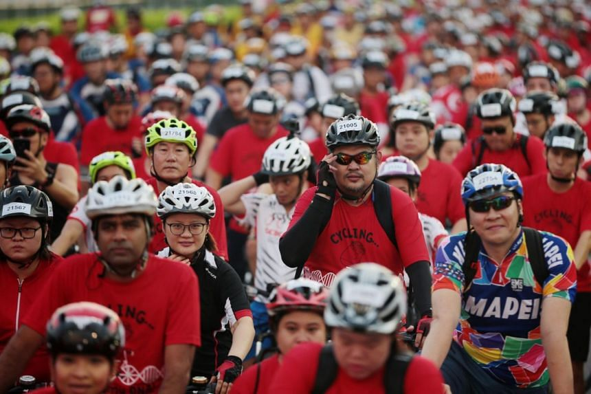 Cyclists wait to be flagged off for the Straits Times Ride during the OCBC Cycle 2019 on May 12, 2019.