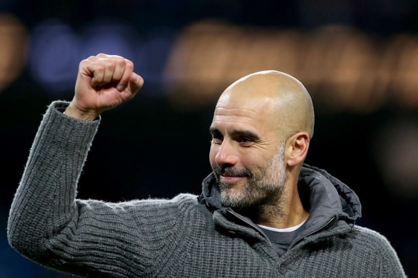 Manchester City's manager Pep Guardiola greets supporters after winning the English Premier League football match between Manchester City and Leicester City at the Etihad Stadium in Manchester, Britain, on May 6, 2019.