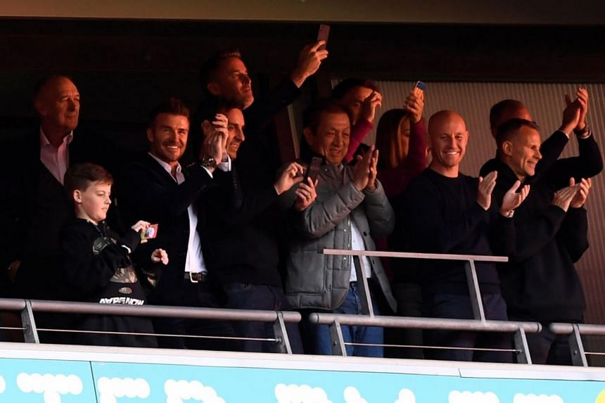 Salford City owners (from third left) David Beckham, Gary Neville, Peter Lim, Nicky Butt and Ryan Giggs in the stands celebrating their club's promotion to League Two for the first time.