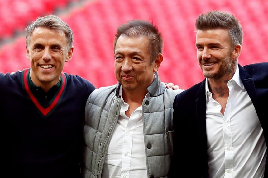 Salford City owners (from left) Phil Neville, Peter Lim and David Beckham celebrate after the match.