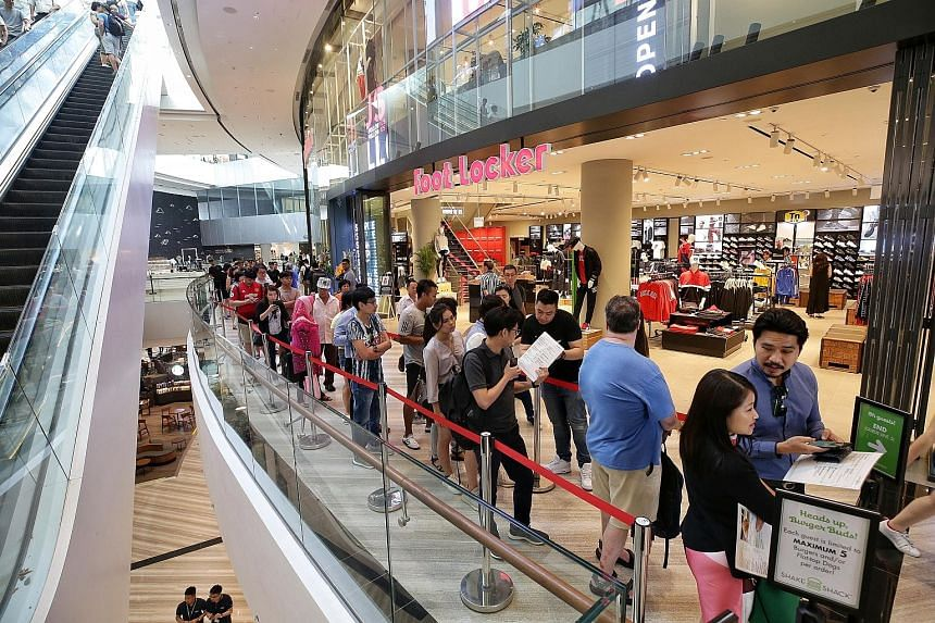 The start of a snaking queue for American fast-food chain Shake Shack in Jewel Changi Airport on April 17. Last week, The Straits Times observed that a massive queue was split into sections to prevent obstruction of the walkway.