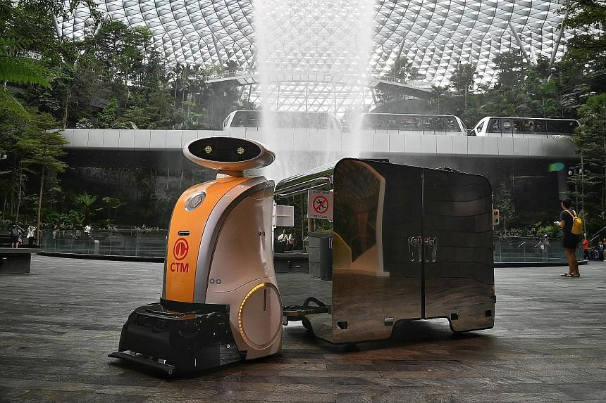 Yi Wei, a pull robot at Jewel Changi Airport, pulling a bin with a 1,000-litre capacity. Tenants can dispose of trash in the bin via an automated opening.