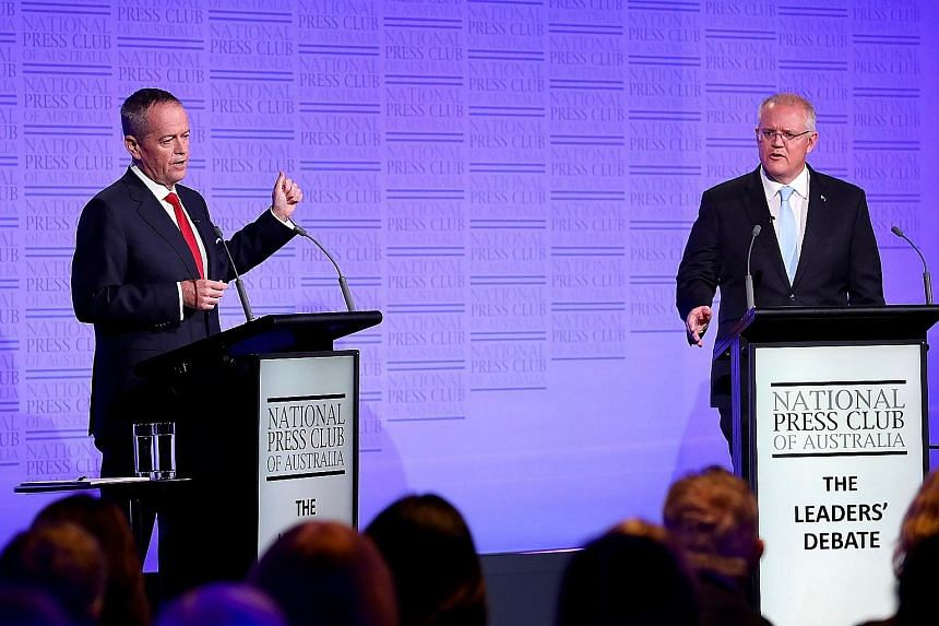 Labor leader Bill Shorten (left) debating with Prime Minister Scott Morrison, the Liberal leader, last Wednesday. Both sides are campaigning through Chinese-language channels to win votes in closely fought seats.