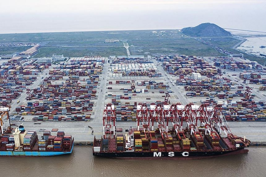 Ships at Yangshan Deepwater Port in Shanghai last Friday, when higher US tariffs on over US$200 billion (S$273 billion) in goods from China kicked in. While Beijing sees a plot to hold back China's development and block its rise, many in Washington f