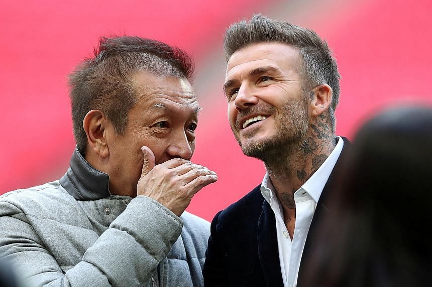 Singapore billionaire Peter Lim, with one of his Salford City co-owners and former Manchester United star David Beckham, is already plotting the League Two club's next three promotions to the Premier League. PHOTO: REUTERS