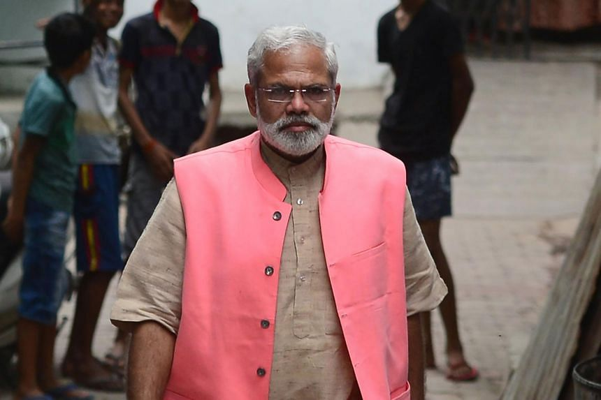Mr Abhinandan Pathak, a lookalike of Indian Prime Minister Narendra Modi, walks on a street as he campaigns in a national election bid as an independent candidate in Lucknow in India's Uttar Pradesh.