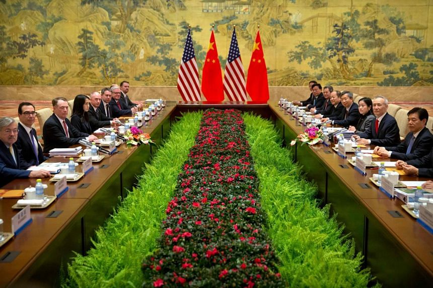 US Treasury Secretary Steven Mnuchin (second, left), US Trade Representative Robert Lighthizer (third, left) and Chinese Vice-Premier and lead trade negotiator Liu He (second, right) before the opening session of trade negotiations at the Diaoyutai S