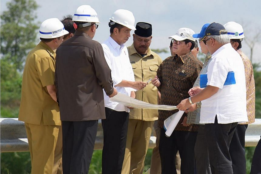 President Joko Widodo (third from left) and other officials at Bukit Soeharto, East Kalimantan province, as he surveyed a possible site for a new Indonesian capital, on May 7, 2019.