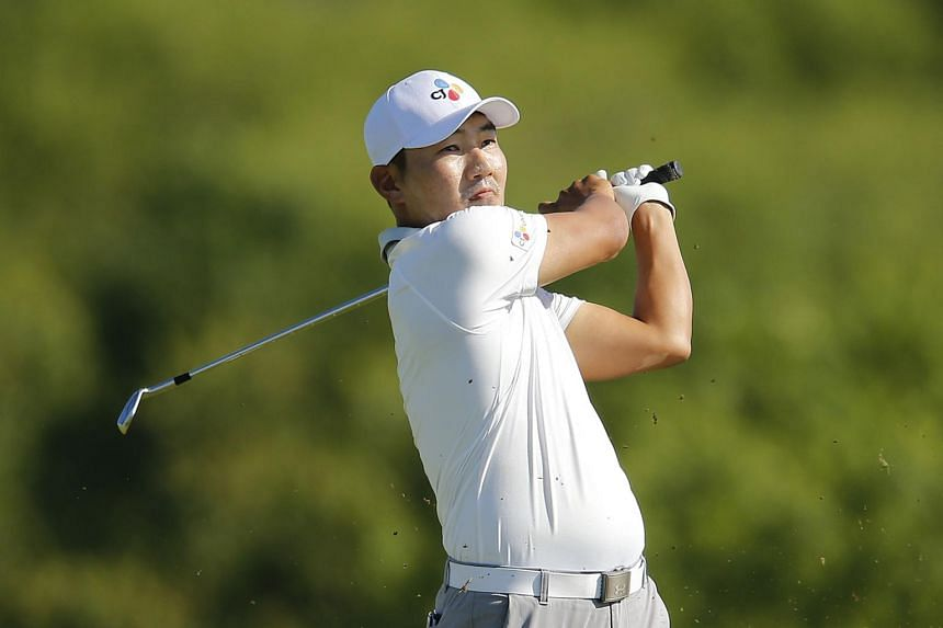 South Korean golfer Kang Sung plays a shot on the 15th hole during the final round of the AT&T Byron Nelson at Trinity Forest Golf Club in Dallas, Texas on May 12, 2019.