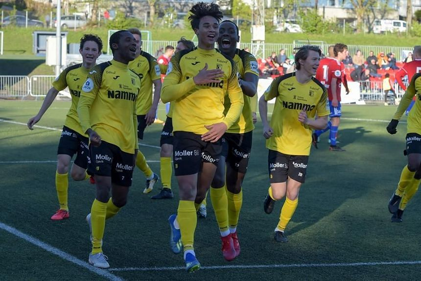 Ikhsan Fandi (centre) cheering with his teammates after his first competitive goal for Raufoss IL in Oslo on May 12, 2019.