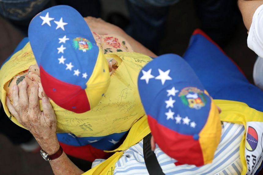 Supporters of Venezuelan opposition leader Juan Guaido take part in a rally in support of the Venezuelan National Assembly in Caracas, Venezuela, on May 11, 2019.