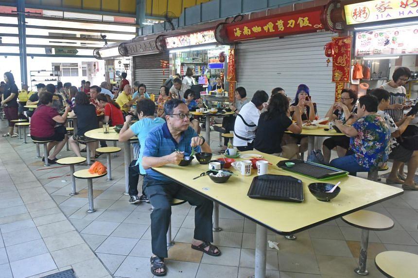 Customers eating at a hawker centre in Ang Mo Kio.