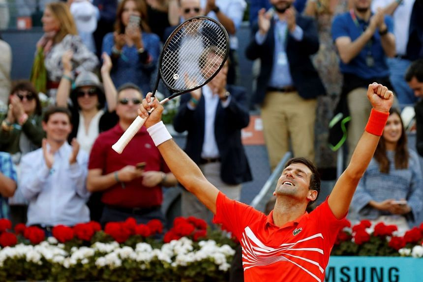 Novak Djokovic of Serbia celebrates winning the final match against Stefanos Tsitsipas of Greece at the Mutua Madrid Open tennis tournament, in Madrid, Spain, on May 12, 2019.