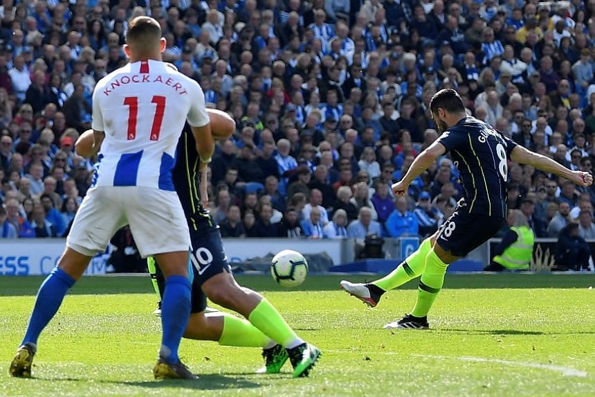 Manchester City's Ilkay Gundogan scores the team's fourth goal against Brighton & Hove Albion at The American Express Community Stadium, Brighton, Britain on May 12, 2019.