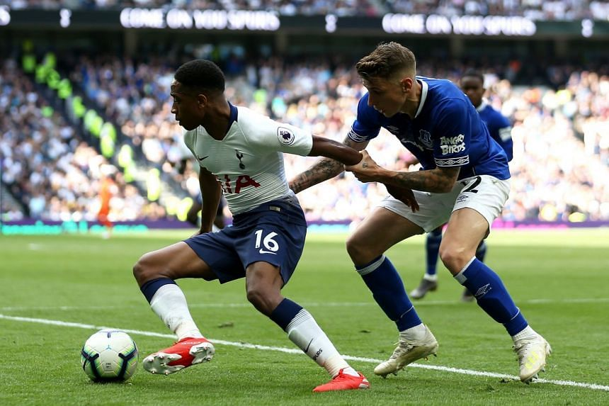 Tottenham Hotspur's Kyle Walker-Peters (left) and Everton's Lucas Digne battle for the ball during the English Premier League soccer match between Tottenham Hotspur and Everton at Tottenham Hotspur Stadium on May 12, 2019.