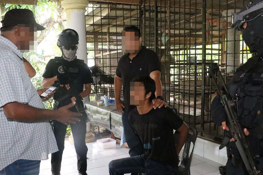 Malaysia's Counter Terrorism Division detaining the mastermind of the cell in Terengganu on May 5.