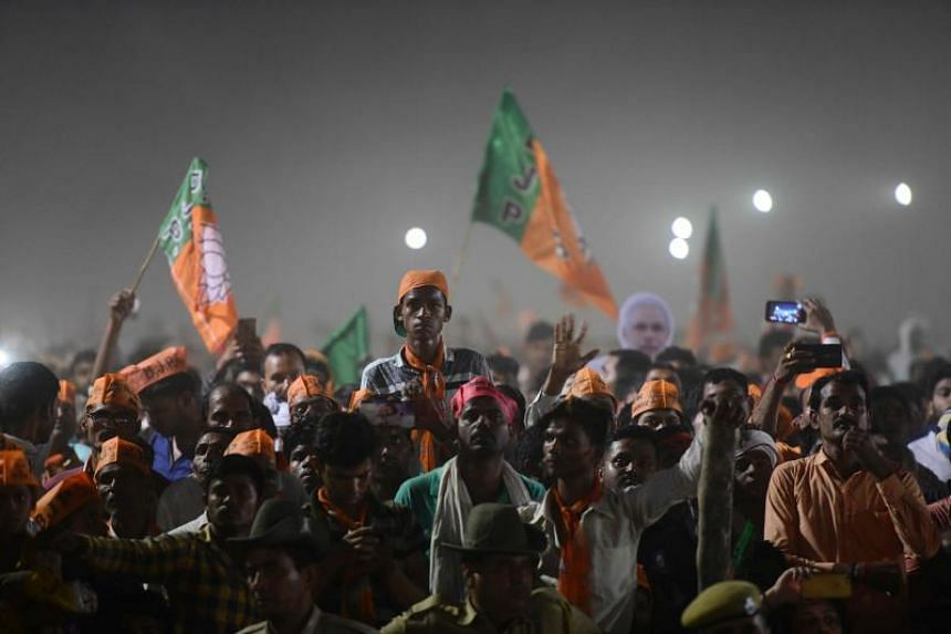 Bharatiya Janata Party supporters attend a rally as Indian Prime Minister Narendra Modi delivers a speech during a rally ahead of Phase VI of India's general election in Allahabad on May 9, 2019.