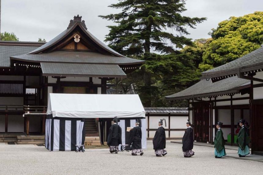For the ceremony, officials clad in long black robes and ornate black hats were seen walking slowly into a striped tent.