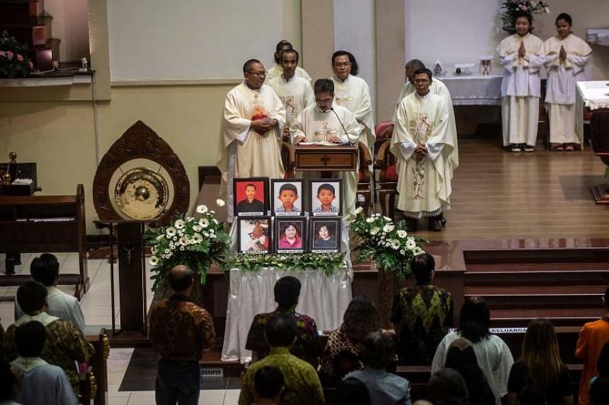 A memorial service at Santa Maria Catholic Church in Surabaya on May 13, 2019, to remember the victims of suicide bombings carried out by an ISIS-inspired family a year ago.