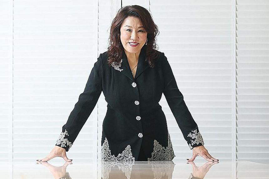 Best World chief executive Dora Hoan (above) is the sister-in-law of Mr Koh Kim Chuan, the sole shareholder of Changsha Best.