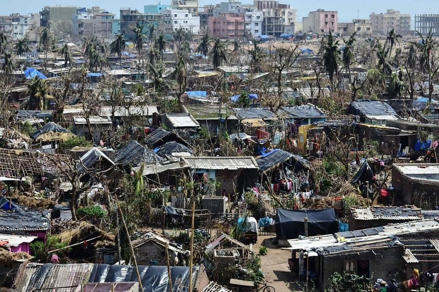Damaged homes in Puri district in India's eastern Odisha state last Friday. Millions of people have been without power or water since Cyclone Fani made landfall on May 3. The death toll in India has risen to 64, with Puri recording the most number of