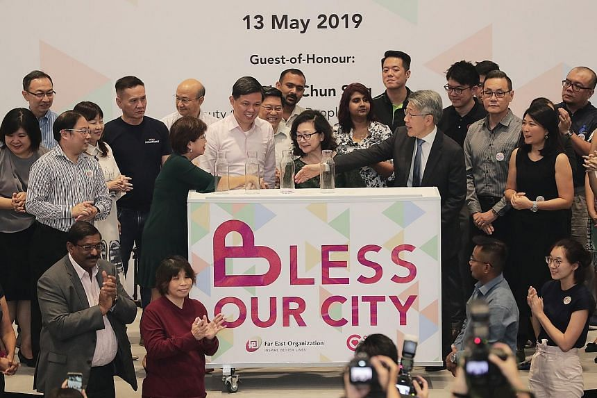 At the podium are (from left) Central Singapore District Mayor Denise Phua, Minister for Trade and Industry Chan Chun Sing, Far Fast Organization executive director Dorothy Chan and chief executive Philip Ng during the launch of the $1 million Bless