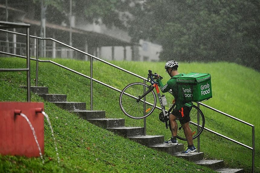 It is not just the postman who has to always deliver. Even as heavy rain pelted Singapore, this GrabFood rider, struggling up the stairs near Guangyang Secondary School in Bishan yesterday afternoon, had to brave the weather to drop off food orders.
