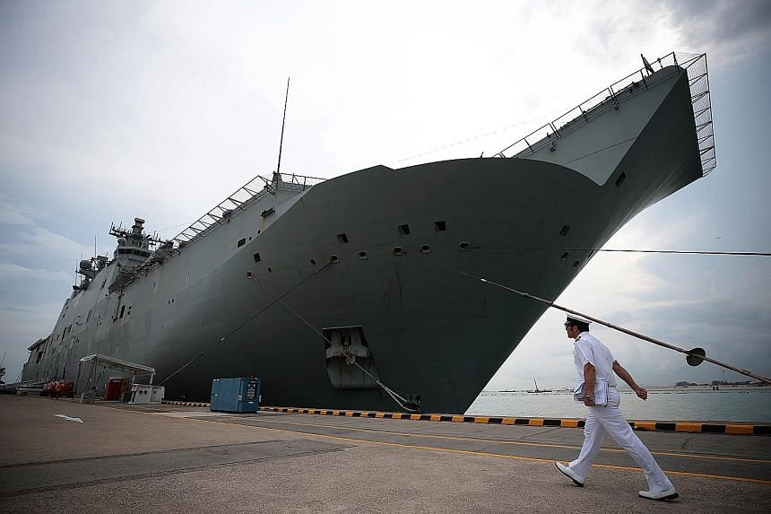 Landing helicopter dock HMAS Canberra, the flagship of the Royal Australian Navy, berthed at RSS Singapura-Changi Naval Base yesterday. The 230m-long ship is making its first appearance in Singapore for the 12th edition of Imdex Asia, a maritime defe