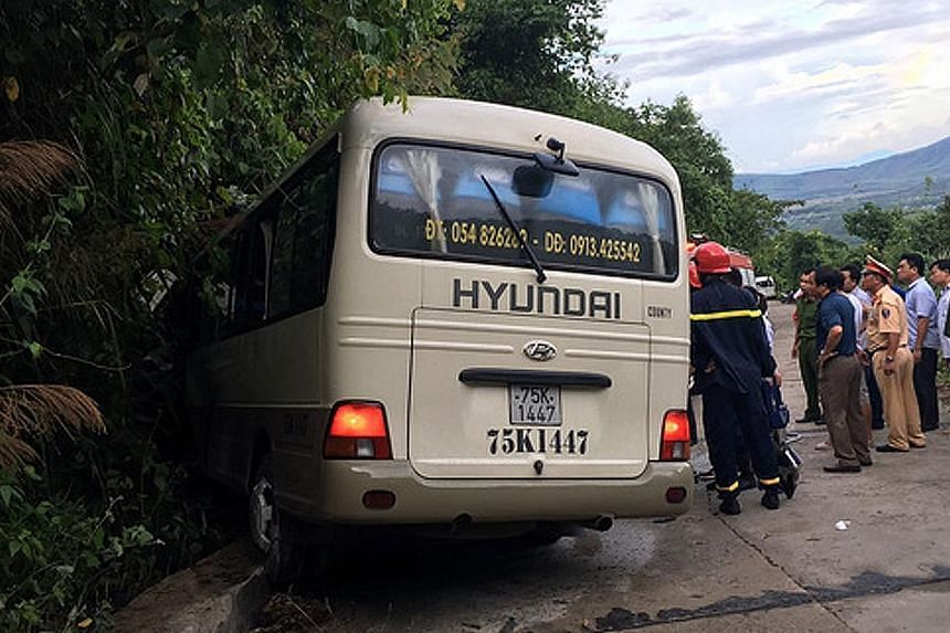 Emergency personnel at the scene of the accident in the central city of Hue, in Vietnam, last Saturday. One of the two buses carrying the students hit a kerb, and all 20 students on board were flung from their seats.