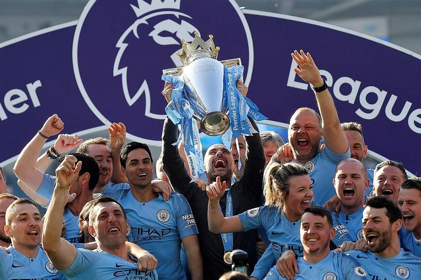 Manager Pep Guardiola lifting the trophy after Manchester City became Premier League champions with a 4-1 victory at Brighton on Sunday. It was the first time a team have retained the Premier League title since Manchester United in 2009.