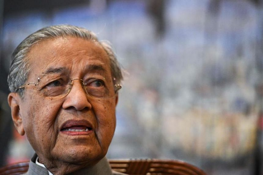 Malaysia extradited a woman wanted by authorities in Thailand over her anti-monarchy views following a request for her deportation, said Prime Minister Mahathir Mohamad.
