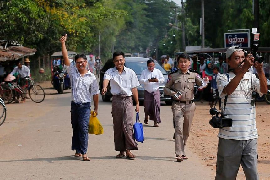 A relentless campaign by their Reuters colleagues, other media outlets and human rights organisations finally saw Wa Lone (left) and Kyaw Soe Oo (centre) reunited with their love ones after more than 500 days behind bars.